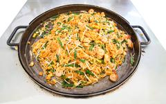 fire noodles with vegetable, tofu and shrimp on pan ( thailand call pad thai - stock photo