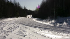 Snowmobiles Race Around Corner Stock Footage