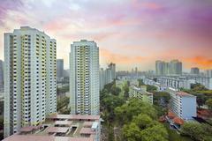 sunset over singapore housing estate - stock photo