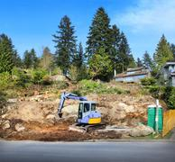 Stock Photo of New House Construction Site In Suburbs