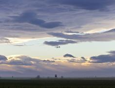 Moody sky at dusk above nationalpark - stock photo