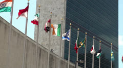 UN headquarters. The Secretariat Building & Member states flags, NYC. - stock footage