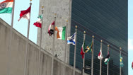Stock Video Footage of UN headquarters. The Secretariat Building & Member states flags, NYC.