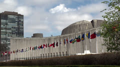 UN headquarters. The General Assembly building & Member states flags, NYC. Stock Footage
