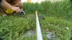 Man mowing the grass in the backyard Stock Footage