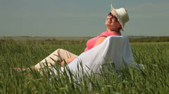 Joyful Senior Lady Relaxing On The Nature Stock Footage