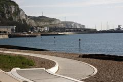 dover sea front, cliffs and port - stock photo