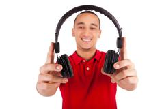 black man having fun listening to music - stock photo