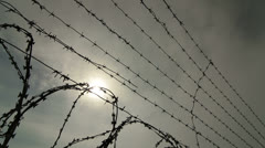 Barbed wire and razor wire fencing - stock footage