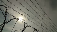Barbed wire and razor wire fencing Stock Footage