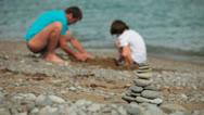 Stock Video Footage of Father and son builds sandcastle