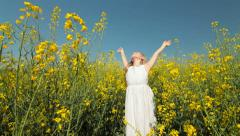 Little Girl Enjoying the Summer in Yellow Meadow Stock Footage