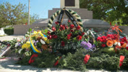 Stock Video Footage of Remembrance wreaths and flowers on war memorial