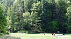 Young golfers mountain golf course green Stock Footage