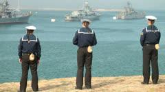 Sailors looking at navy ships Stock Footage
