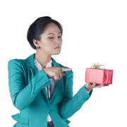 Portrait of beautiful asian woman holding a gift box Stock Photos