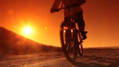 Stock Video Footage of Man Cycling at Sunrise