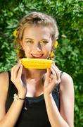 woman eating corn-cob - stock photo