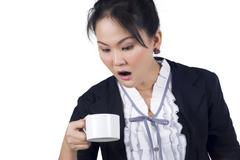 portrait of business woman hold cup of coffee - stock photo