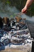 preparing barbecue embers - stock photo