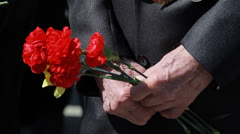 Grandfather is holding flowers Stock Footage
