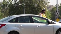 Traffic Officer directs traffic in Los Angeles Stock Footage