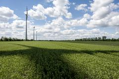 Rotor shadow in wind power field Stock Photos