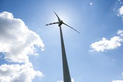 Single wind power engine with clouds and sky Stock Photos