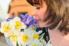 middle-aged woman with flowers - stock photo
