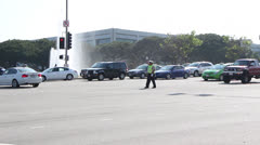 Traffic Officers direct traffic in Los Angeles Stock Footage