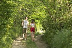 Brother and sister on the forest path - stock photo