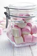 sweet marshmallows in glass jar - stock photo