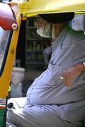 sikh driver waiting for passenger, new delhi, india - stock photo