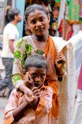 Two children begging Stock Photos