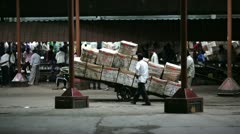 MUMBAI, INDIA - MARCH 2013: Goods ready for transportation assembled on platform Stock Footage