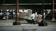Stock Video Footage of MUMBAI, INDIA - MARCH 2013: Goods ready for transportation assembled on platform