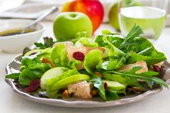 Apple with Pommelo, Cranberry and Almond salad - stock photo