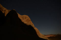 4K Astrophotography Time Lapse Moon Shadow Sweeping Across Sandstone Stock Footage