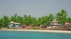 Idyllic holiday resort on sandy beach by the sea Stock Footage