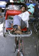 Youth sleeping on rickshaw, old delhi, india Stock Photos