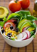 Avocado with Corn and Olive salad - stock photo