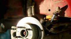 Zoom in tire suspension close up Stock Footage
