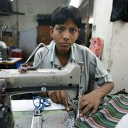 Young boy in textile factory Stock Photos