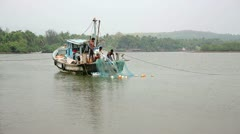GOA, INDIA - MARCH 2013: Members of fishing crew preparing to cast nets Stock Footage