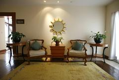Chairs in entrance hall to hotel Stock Photos