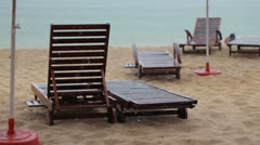 Tropical rain beach and deck chair Stock Footage