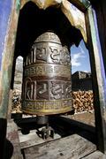 decorated praying wheel on annapurna circuit, nepal - stock photo