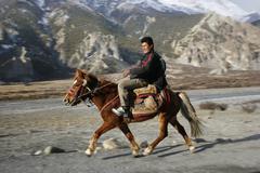 Horse back rider on path, annapurna, nepal Stock Photos