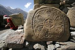 tibetan mani prayer stones, annapurna, nepal - stock photo