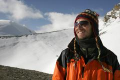 Mountaineer enjoying the summit after a climb up thorong-la pass, annapurna,  Stock Photos